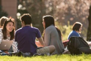 UW students sitting in quad on sunny day